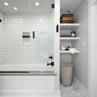 Bathroom - small traditional master white tile and ceramic tile ceramic floor and gray floor bathroom idea in Kansas City with recessed-panel cabinets, medium tone wood cabinets, white walls and gray countertops