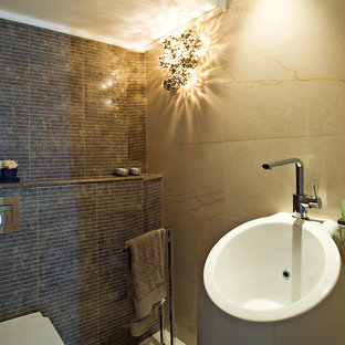 Trendy brown tile bathroom photo in Tel Aviv with a pedestal sink