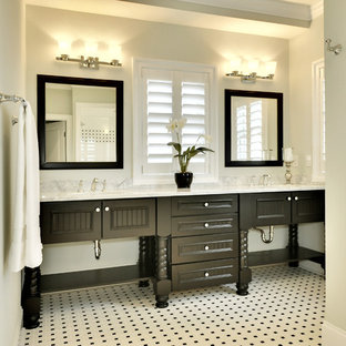 Photo of a beach style bathroom in Other with black cabinets and black and white tile.