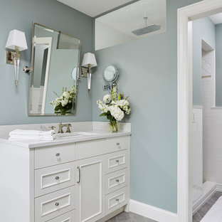Example of a mid-sized classic master ceramic floor and gray floor freestanding bathtub design in Minneapolis with recessed-panel cabinets, white cabinets, blue walls, an undermount sink and granite countertops