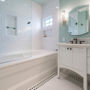 Mid-sized beach style 3/4 white tile and subway tile mosaic tile floor and white floor bathroom photo in Los Angeles with furniture-like cabinets, white cabinets, green walls, an undermount sink, marble countertops and white countertops