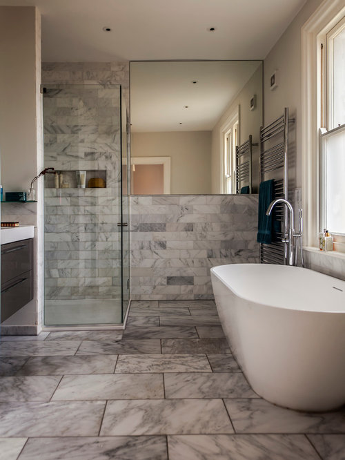 Small Contemporary Ensuite Bathroom In Hampshire With Flat Panel Cabinets,  A Freestanding Bath,