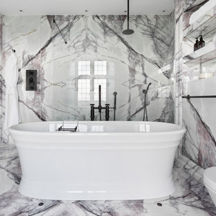 Design ideas for a large contemporary master bathroom in Oxfordshire with louvered cabinets, purple cabinets, a freestanding tub, an open shower, white tile, marble, marble floors, a trough sink, marble benchtops, multi-coloured floor and white benchtops.