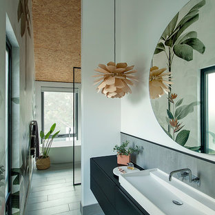 Design ideas for a mid-sized contemporary master bathroom in Perth with furniture-like cabinets, black cabinets, a freestanding tub, an open shower, gray tile, ceramic tile, white walls, ceramic floors, a vessel sink, laminate benchtops, grey floor, an open shower and black benchtops.