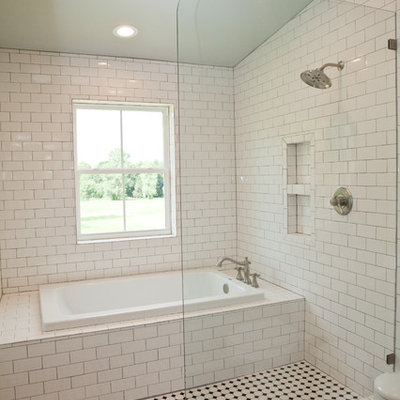 Bathroom - mid-sized cottage master white tile and subway tile ceramic tile and black floor bathroom idea in Oklahoma City with white walls and a wall-mount sink