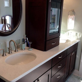 Large coastal master green tile and porcelain tile marble floor and white floor corner shower photo in Philadelphia with shaker cabinets, dark wood cabinets, a two-piece toilet, white walls, an integrated sink, engineered quartz countertops and a hinged shower door