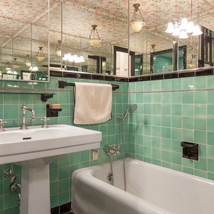 Elegant green tile and ceramic tile alcove bathtub photo in San Francisco with a pedestal sink