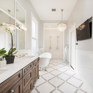 Bathroom - traditional bathroom idea in San Francisco with recessed-panel cabinets, dark wood cabinets and gray walls