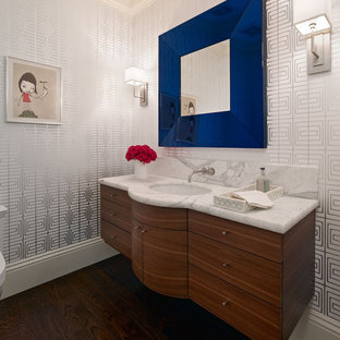 Trendy bathroom photo in San Francisco with an undermount sink, flat-panel cabinets and dark wood cabinets