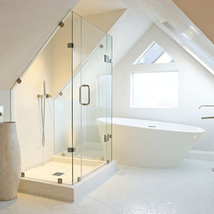 Bathroom - contemporary white tile and mosaic tile white floor bathroom idea in San Francisco with beige walls and a hinged shower door