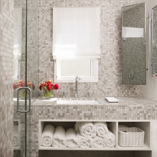 Contemporary bathroom in Los Angeles with a submerged sink, open cabinets, tiled worktops, an alcove shower, grey tiles and mosaic tiles.