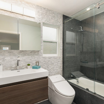 Small minimalist master black tile and cement tile ceramic tile bathroom photo in San Francisco with an integrated sink, flat-panel cabinets, dark wood cabinets, quartz countertops, a wall-mount toilet and gray walls
