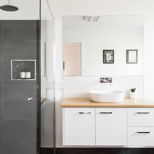 Photo of a contemporary bathroom in Hobart with flat-panel cabinets, white cabinets, white walls, a vessel sink, wood benchtops and beige benchtops.