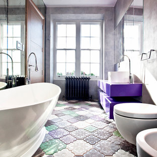 Inspiration for a contemporary multicolored floor freestanding bathtub remodel in London with a vessel sink, flat-panel cabinets, a wall-mount toilet and gray walls