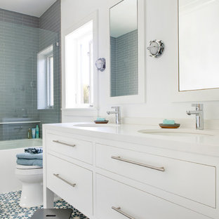 Small trendy kids' white tile and glass tile cement tile floor and blue floor bathroom photo in Los Angeles with flat-panel cabinets, white cabinets, white walls, an undermount sink, engineered quartz countertops and white countertops