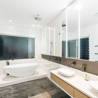 This is an example of a contemporary master bathroom in Gold Coast - Tweed with flat-panel cabinets, light wood cabinets, a freestanding tub, a curbless shower, white walls and a vessel sink.