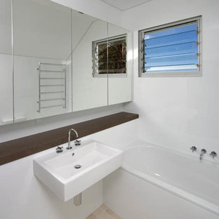 Inspiration for a small beach style kids' beige tile and stone tile drop-in bathtub remodel in Sydney with a wall-mount sink and white walls