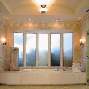 Bathroom - huge transitional master beige tile and stone slab limestone floor and beige floor bathroom idea in Orange County with raised-panel cabinets, beige cabinets, a one-piece toilet, white walls, a drop-in sink, limestone countertops and a hinged shower door