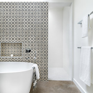 Example of a large trendy master ceramic tile and black and white tile concrete floor and gray floor bathroom design in Austin with white walls