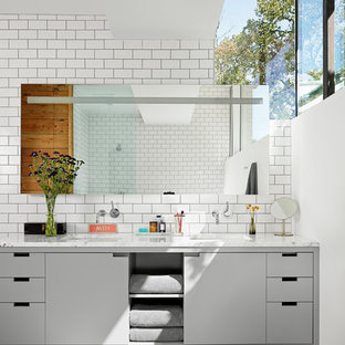 Bathroom - contemporary white tile and subway tile bathroom idea in Austin with an undermount sink, flat-panel cabinets and gray cabinets