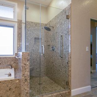 Ejemplo de cuarto de baño principal, clásico, grande, con armarios con paneles con relieve, puertas de armario de madera en tonos medios, bañera encastrada, ducha empotrada, baldosas y/o azulejos marrones, losas de piedra, paredes blancas, suelo de pizarra, lavabo bajoencimera, encimera de terrazo, suelo multicolor y ducha con puerta con bisagras