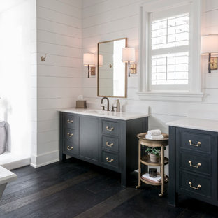 Design ideas for a nautical ensuite bathroom in Other with a submerged sink, black cabinets, white walls, dark hardwood flooring, marble worktops and recessed-panel cabinets.