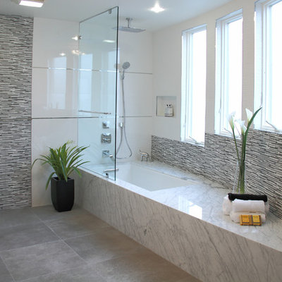 Example of a trendy gray tile and matchstick tile tub/shower combo design in San Francisco with an undermount tub