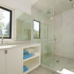 Inspiration for a modern white tile bathroom remodel in San Francisco with an integrated sink, flat-panel cabinets and white cabinets