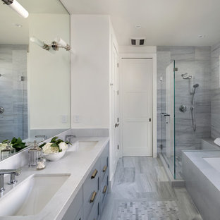 Example of a large cottage master gray tile gray floor and porcelain floor corner shower design in San Francisco with shaker cabinets, gray cabinets, an undermount tub, white walls, an undermount sink, white countertops, a two-piece toilet, laminate countertops and a hinged shower door