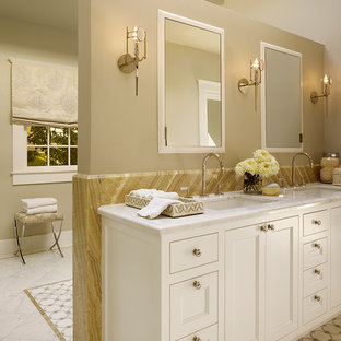 Large transitional master beige tile and stone tile mosaic tile floor bathroom photo in San Francisco with an undermount sink, recessed-panel cabinets, white cabinets, marble countertops, a one-piece toilet and gray walls