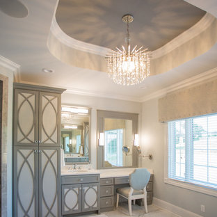 Transitional master marble floor bathroom photo in Other with recessed-panel cabinets and gray walls