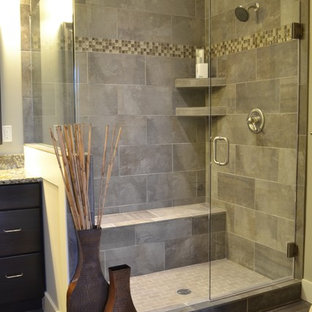 Inspiration for a mid-sized craftsman master gray tile and ceramic tile ceramic floor corner shower remodel in Cincinnati with dark wood cabinets, granite countertops and gray walls