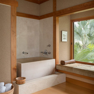 Large asian master beige tile and limestone tile medium tone wood floor and brown floor bathroom photo in Hawaii with beige walls and medium tone wood cabinets