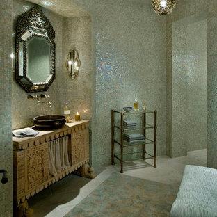 Ejemplo de cuarto de baño mediterráneo con lavabo sobreencimera, armarios tipo mueble, puertas de armario de madera oscura, ducha empotrada, baldosas y/o azulejos en mosaico y baldosas y/o azulejos beige