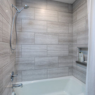 This is an example of a medium sized contemporary family bathroom in Phoenix with a submerged sink, recessed-panel cabinets, grey cabinets, quartz worktops, a built-in bath, a shower/bath combination, grey tiles, ceramic tiles, grey walls, terracotta flooring, a one-piece toilet, brown floors and a shower curtain.