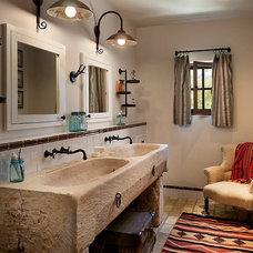 Southwestern Bathroom by Calvis Wyant Luxury Homes