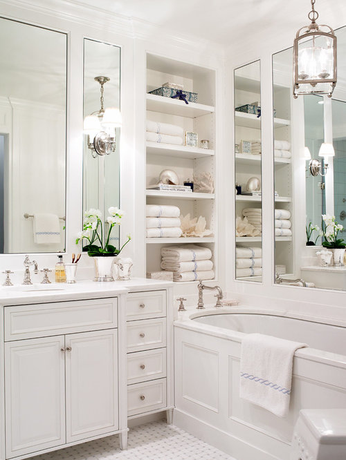 small elegant master bathroom photo in new york with an undermount sink white cabinets