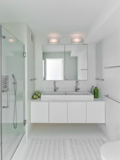 Small trendy bathroom photo in Other with white tile, white walls and ...