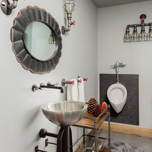Example of an urban concrete floor and gray floor bathroom design in Salt Lake City with an urinal, gray walls and a vessel sink