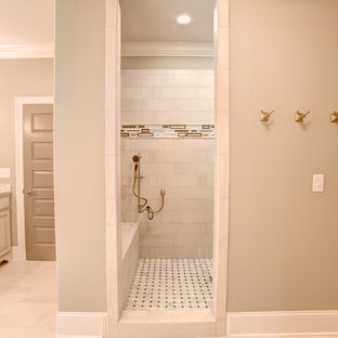 Mid-sized tuscan beige tile, pink tile and ceramic tile travertine floor bathroom photo in Other with raised-panel cabinets, light wood cabinets, a two-piece toilet, beige walls, an undermount sink and marble countertops