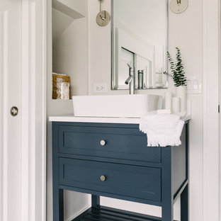Example of a mid-sized transitional 3/4 white tile and subway tile cement tile floor and blue floor bathroom design in Chicago with blue cabinets, white walls, a vessel sink, furniture-like cabinets, white countertops and solid surface countertops