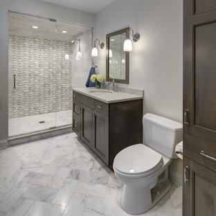 Design ideas for a mid-sized transitional 3/4 bathroom in Chicago with recessed-panel cabinets, dark wood cabinets, an alcove shower, a two-piece toilet, grey walls, an undermount sink, quartzite benchtops, white floor, a hinged shower door and beige benchtops.
