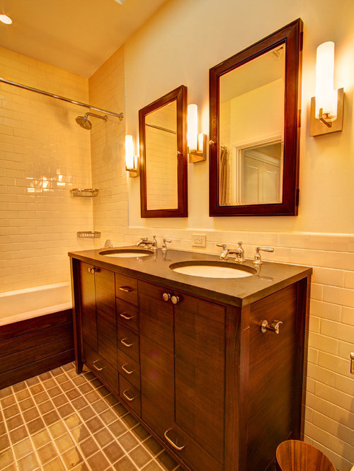 elegant bathroom photo in new york with an undermount sink dark wood cabinets engineered
