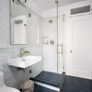 Corner shower - small contemporary gray tile and mosaic tile porcelain tile, black floor and single-sink corner shower idea in New York with a one-piece toilet, white walls, a wall-mount sink and a hinged shower door
