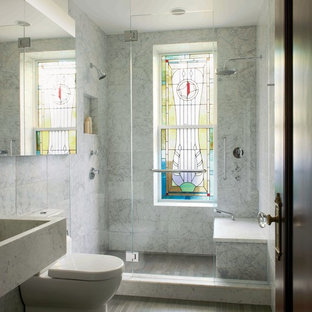 Trendy alcove shower photo in New York with an integrated sink and a two-piece toilet