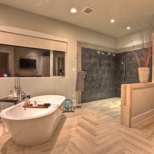Inspiration for a contemporary beige floor bathroom remodel in Houston
