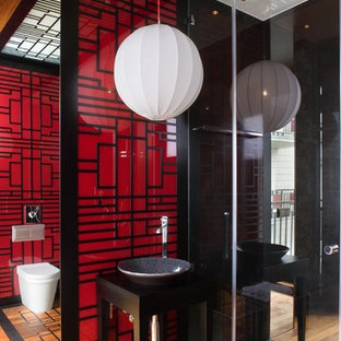 Photo of an asian bathroom in Other with a vessel sink and red walls.
