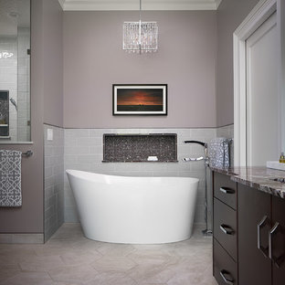 Inspiration for a large transitional master gray tile and ceramic tile porcelain floor and gray floor bathroom remodel in Other with flat-panel cabinets, medium tone wood cabinets, a two-piece toilet, gray walls, an undermount sink, marble countertops, a hinged shower door and red countertops