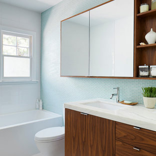 Inspiration for a contemporary bathroom in Los Angeles with flat-panel cabinets, dark wood cabinets, blue tiles and glass tiles.