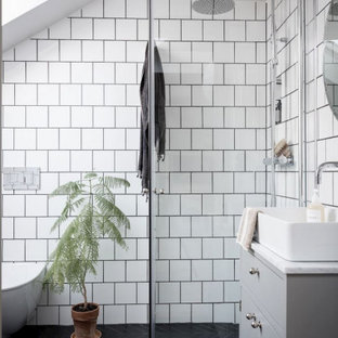 Inspiration for a contemporary bathroom in Sydney with flat-panel cabinets, grey cabinets, a curbless shower, a vessel sink, black floor, a hinged shower door, white benchtops, a single vanity and a freestanding vanity.
